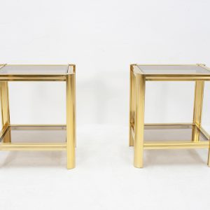 Two small brass side tables