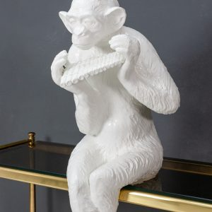 Large sitting ceramic chimpanzee  playing the panpipes